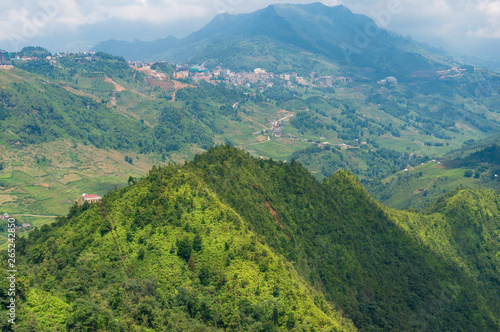 Leinwand Poster  Panoramic view of mountain valley in Vietnam