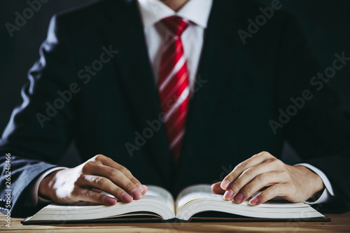 Photo 分厚い本とビジネスマン
