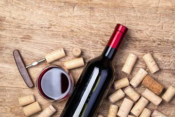 red wine bottle on wooden