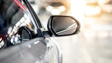 Close Up Of Metallic Wing Mirror Of Modern Car. Auto Transport Or Automobile Industry Concepts