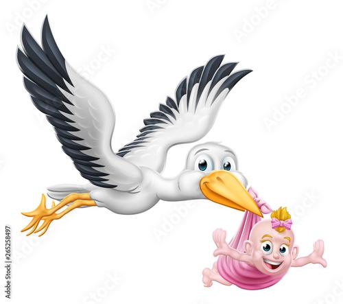 Fototapeta A stork or crane cartoon bird flying through the sky carrying a new born baby as in the pregnancy myth