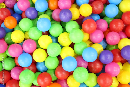 Poster Confiserie pool with colored balls in baby playground