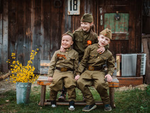 Young Child In Military Uniform On Holiday Day Of Victory, May 9, Russia.