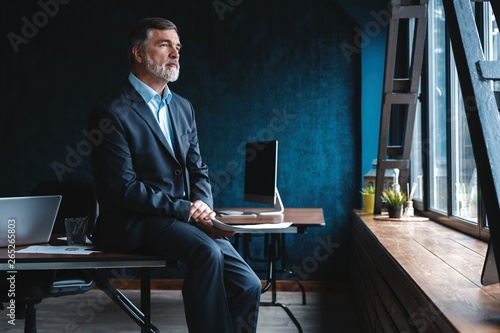 Fototapety, obrazy: Confident pensive mature business man in modern office.