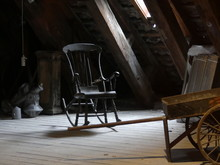 Old Rocking Chair In The Attic. Old Chair In The Attic. Cart In The Attic. Strict, Unnecessary Things In The Closet.