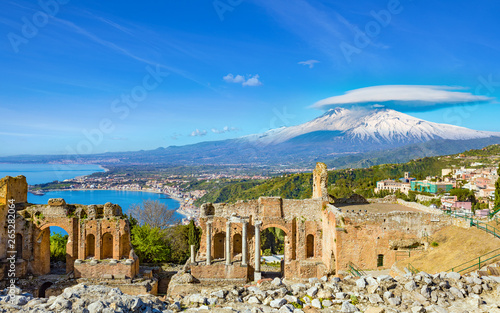Ancient Greek theatre in Taormina on background of Etna Volcano, Italy