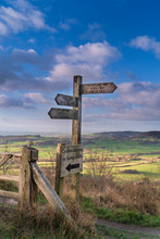 Signpost And Distant View Of The Vale Of York From Whitestone Cliff, North Yorkshire Moors, Yorkshire