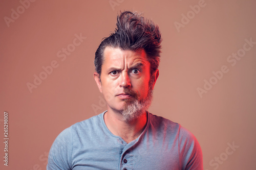 A portrait of man with half beard and hair
