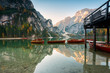 Lake of Braies in autumn with the typical boats of the place, Bolzano Province, Trentino-Alto Adige
