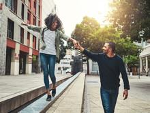 Cheerful Couple Enjoying Walking In The City