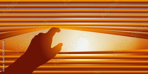 Fototapeta Concept de la surveillance avec une main qui relève les lames d'un store vénitien pour regarder par la fenêtre le ciel d'une journée ensoleillée