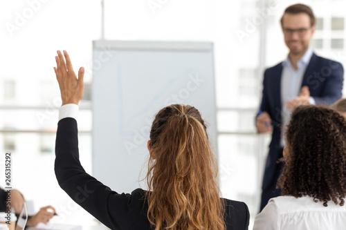 Training participant raise hand ask question at employees team workshop Canvas Print