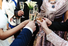 Hands Of Happy People Toasting...