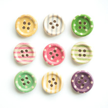 Wooden Buttons With Colorful Stripes And Colorful Dots On A White Background