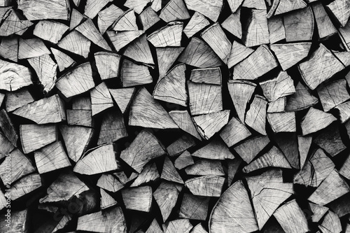 Staande foto Brandhout textuur natural stocked firewood in a pile, wooden abstract background, energy enviroment concept