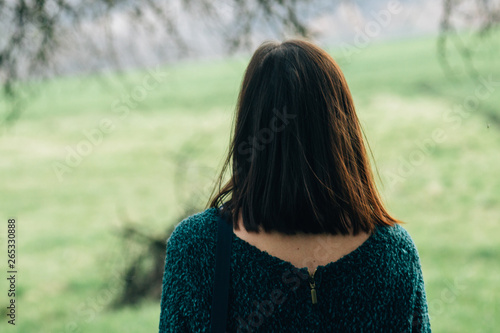 Valokuva  stylish beautiful brunette girl walking with photocamera outdoors in spring