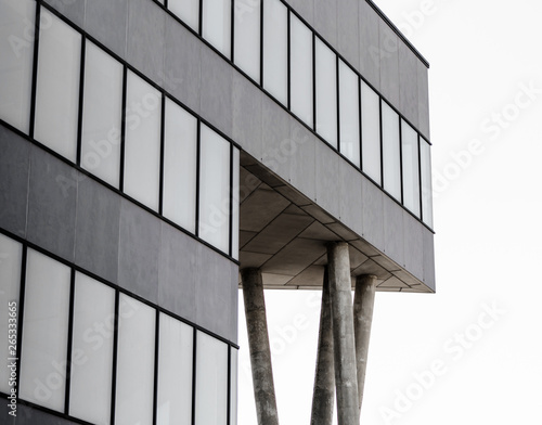 Türaufkleber Darknightsky gray concrete structure with columns and empty windows
