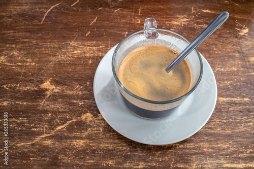 Cafe Cubano in in a glass mug on a wooden table Wallpaper Mural