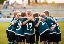 Kids Football Team Building Team Spirit. Soccer Children Team In Huddle. Group Of Boys United Before The Final Soccer Match