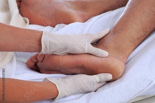 Fotografía  Healthcare environment with caregiver checking patients foot