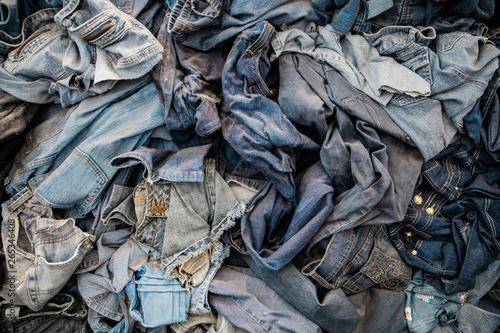 Pile of Old Vintage Denim Jeans Being Repurposed Fototapet