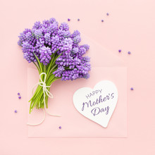 Spring Lilac Flowers And A Heart Shape Card Happy Mother's Day On Pink Envelope.