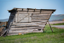 Side View Of Old Wooden Shed Falling Apart