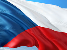 Flag Of Czech Republic Waving In The Wind Against Deep Blue Sky. High Quality Fabric.