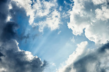 Sun Rays Shining Through The Clouds To The Blue Sky; Canada