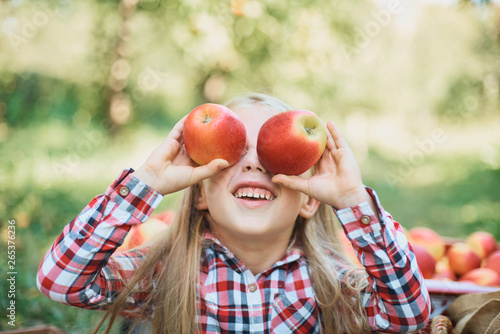 Vászonkép  Girl with Apple in the Apple Orchard