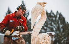 Artist Carving A Wood Sculptur...