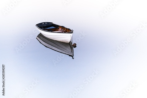 A little rowboat with reflection in the water Fototapet