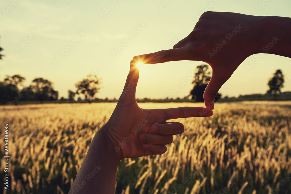 Fototapety, obrazy: people make hand framing looking distant view sunrise. business concept