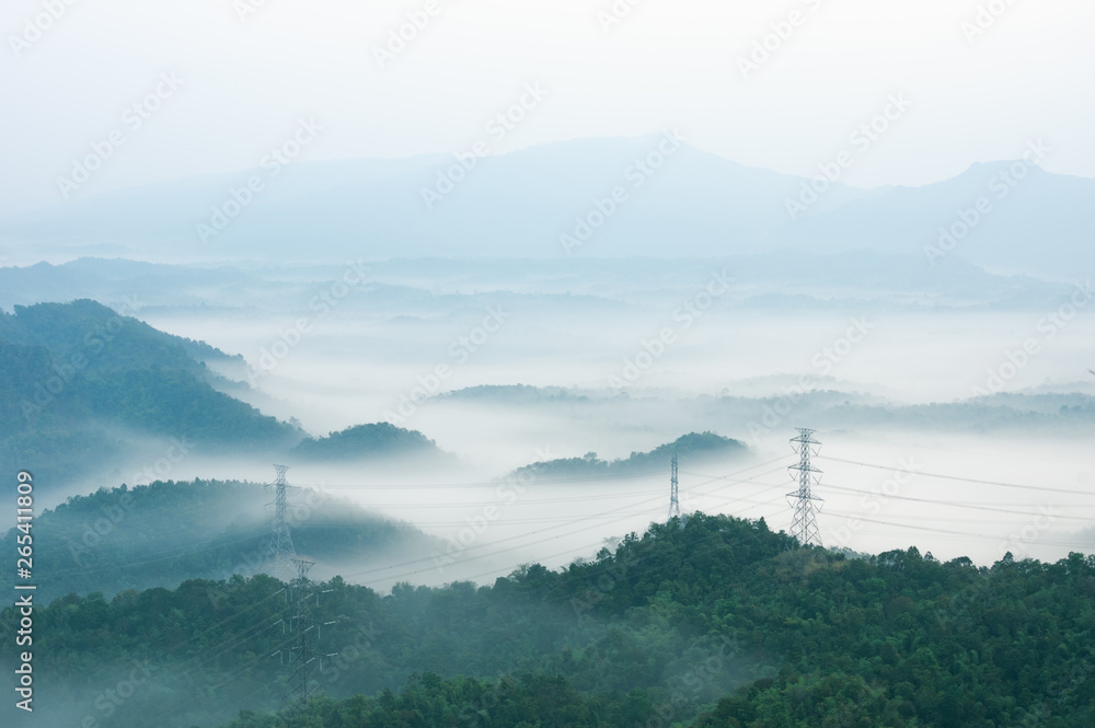 Fototapety, obrazy: Electric transmission towers in fog