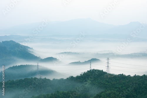Foto auf AluDibond Licht blau Electric transmission towers in fog