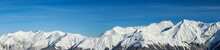 Panoramic View Of The Caucasus Mountains Covered By Snow In The Ski Resort Of Krasnaya Polyana, Russia.
