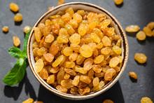 Golden Raisins In Bowl Closeup. Dried Grapes Or Sultanas. Arabic Food
