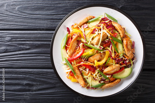 Fotomural Asian cabbage salad with chicken and vegetables close-up on a plate