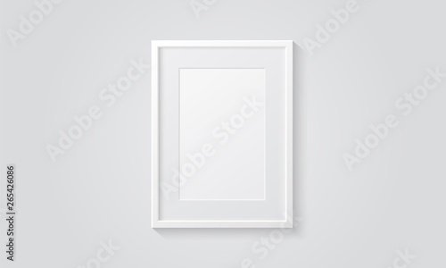 Obraz Picture frame isolated on a wall. White color. Realistic modern template. A4 vertical format. Mock up for pictures or photo. Beautiful minimal clean design. Eps 10 vector illustration. - fototapety do salonu