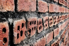 Rustic Red Brick Wall Texture Background. Angle View.