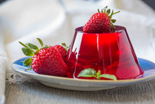 Photo Of Fruit Jelly With Fresh Strawberry. Healthy Food. Strawberry Jelly On White Plate. Summer Dessert With Fruit Jelly And Fresh Strawberry.