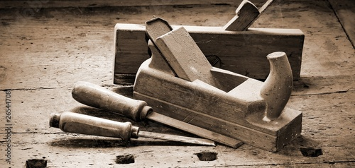 two old planes and two chisels over the work table with sepia to Canvas Print