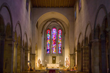 Colorful Window Inside Of The Abbey Of Echternach (Basilica Of Saint Willibrord) In Echternach, Luxembourg, With The Altar And Statues