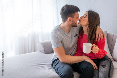 Obraz na plátně  Couple at home relaxing in sofa