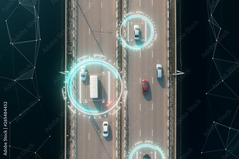 Fototapeta 4k aerial view of self driving autopilot cars driving on a highway with technology tracking them, showing speed and who is controlling the car. Visual effects clip shot.