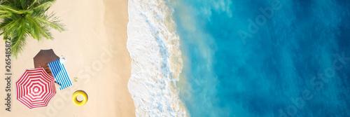 Foto op Plexiglas Strand Aerial view of umbrella,towel on sand beach