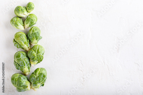 Stickers pour portes Bruxelles Fresh raw organic brussels sprouts on white background. Top view, flat lay, copy space.