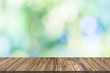 Wooden table on tree bokeh background.