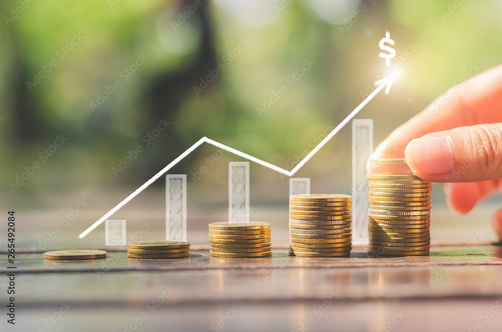 Fototapety, obrazy: loan investment residential building house, real estate, property, mortgage concept. hand put coin stacking on wood table in green park background. startup graph growth up wealth.ESG.financial saving.