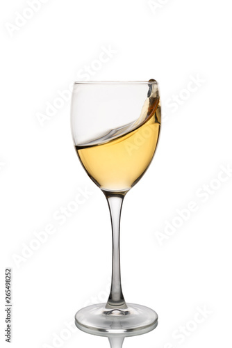 Foto op Canvas Alcohol White wine in a wine glass with splashes isolated on white background.